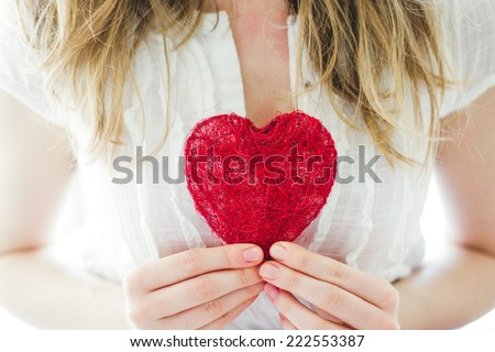 love concept, woman holding heart