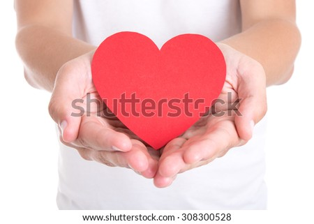 love concept - young man holding red paper heart in hands