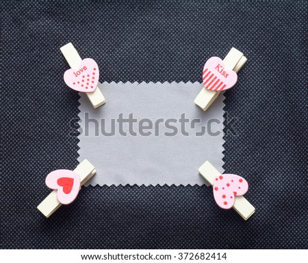 Love conceptual background with wood clips,love shape on grey paper - stock photo