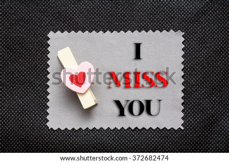 "Love conceptual background with wood clips,love shape on grey paper ""I Miss You"" - stock photo"