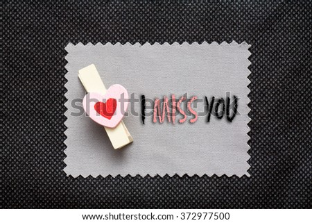 "Love conceptual background with wood clips,love shape on grey paper "" I miss You"" - stock photo"
