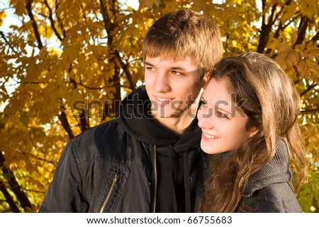 Love couple enjoying the sunny autumn day