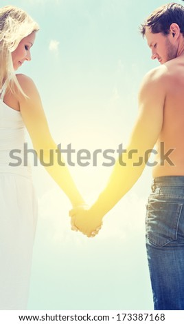 love couple man and woman holding hands on a sky background - stock photo