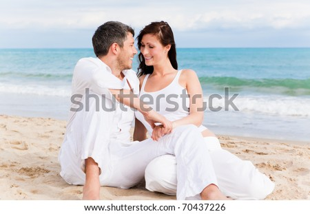 Love couple sitting on the beach