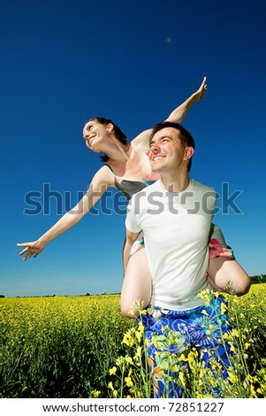 love Couple smiling under blue sky - stock photo