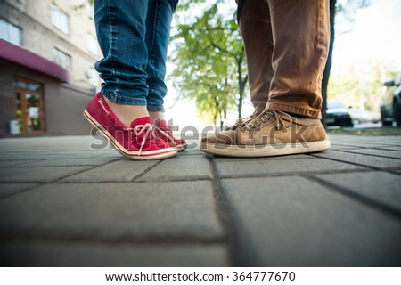love couple standing on the sidewalk, Legs man and woman - stock photo