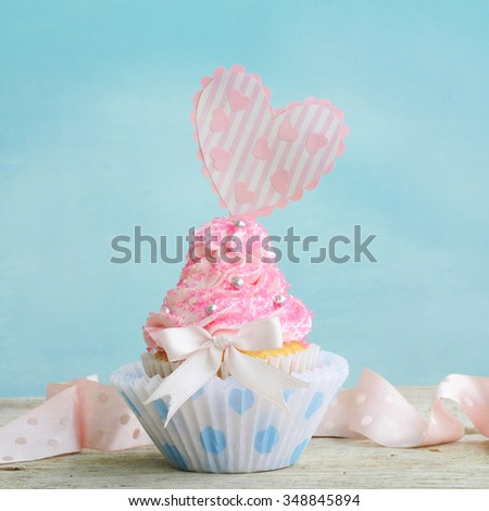 Love cupcake with hearts and butter cream - stock photo
