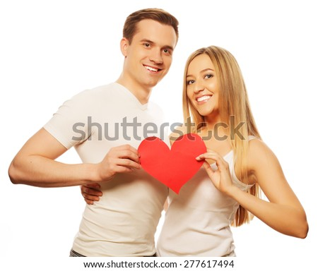 Love, family and people concept: Happy couple in love holding red heart - stock photo