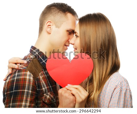 Love, family and people concept: Happy couple in love holding red heart. - stock photo