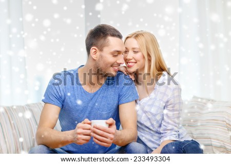 love, family, drinks and people concept - smiling couple with cup of tea or coffee at home - stock photo