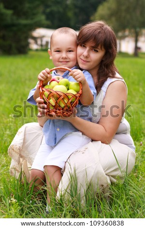 Love family having picnic in green park against blurred background of summer nature