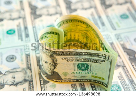 love for money. us dollars in heart shape. abstract background.