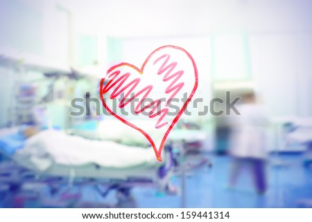 Love for the medical profession. Figure in the form of heart on the background of a hospital ward. - stock photo