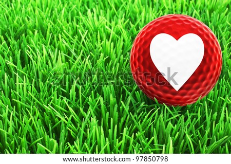 Love Golf - red golf-ball with white heart on the fairway - stock photo
