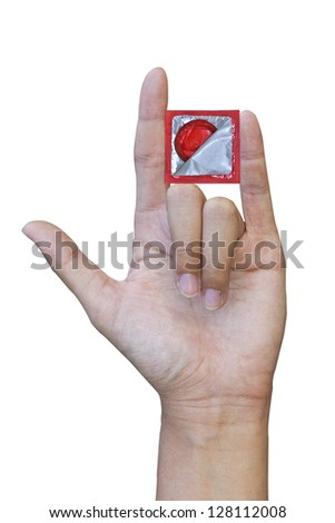 Love hand sign and condom (with clipping path) - stock photo