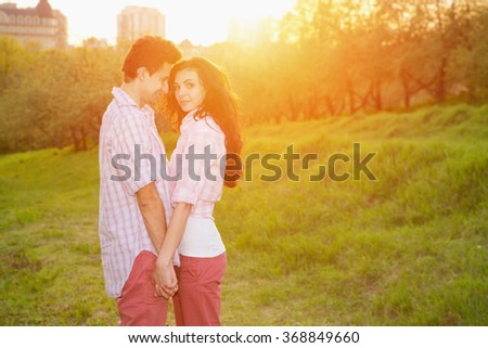 Love. Happy couple, man and woman. Sunset, city park, outdoor, sun day - love concept. Spring love story. - stock photo