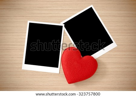 Love heart and Photo frame or polaroid on Brown wood plank wall texture background - stock photo