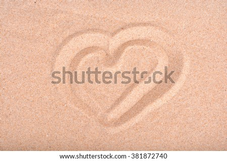 Love heart drawn in beach sand.