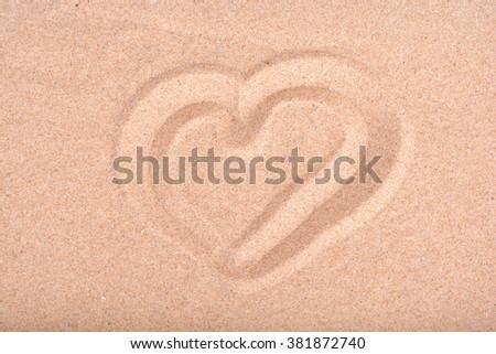 Love heart drawn in beach sand. - stock photo