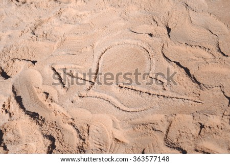 Love heart drawn in the sand on the atlantic coast - stock photo