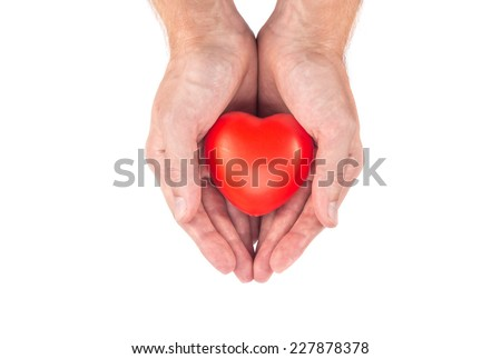 Love heart in man hands isolated on white background - stock photo