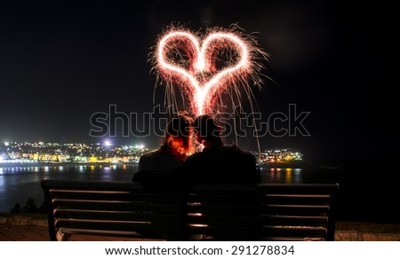Love heart - light painting at Beach - stock photo