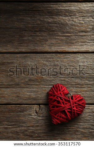 Love heart on a grey wooden background - stock photo