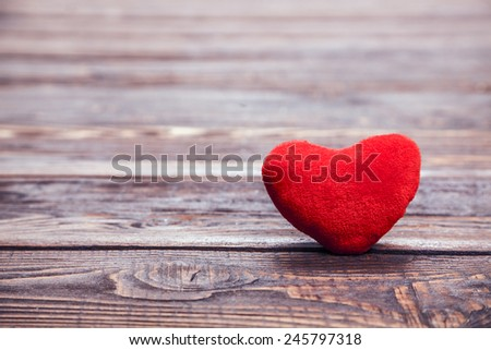 Love heart on breakage wood texture background, valentines day card concept - stock photo