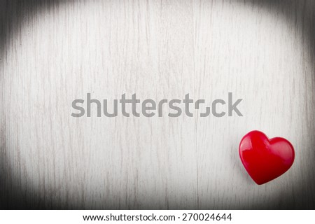 Love heart on wood texture background, valentines day card concept - stock photo