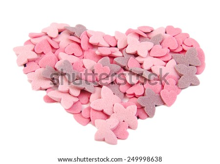 Love heart shape formed with sugar items isolated on white background. Love concept. Valentine's Day concept