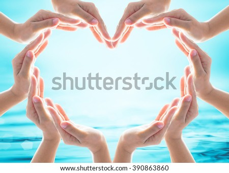 Love heart shape symbolic sign of women human hands on blur blue turquoise sea ocean river background: World water day March 22 design logo concept: Saving aqua csr environmental protection campaign - stock photo