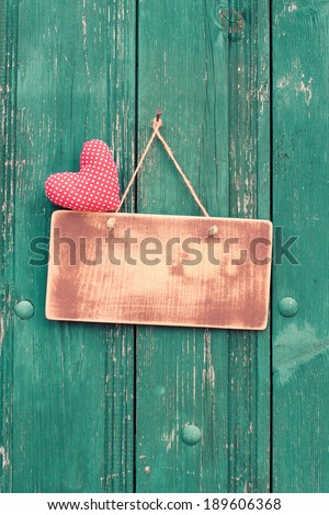 Love heart, sign board on vintage wooden background - stock photo
