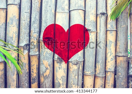 Love heart symbol on old bamboo wall background for valentine