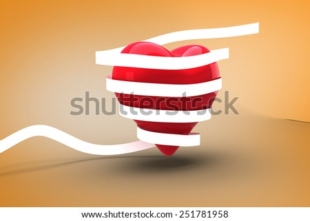 Love heart wrapped in ribbon against orange vignette