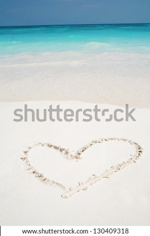 love hearts drawn in beach, beautiful beach surface texture background ,travel landscape clean white sand beach and blue sea water wave ripple background, beautiful ocean and natural beach island