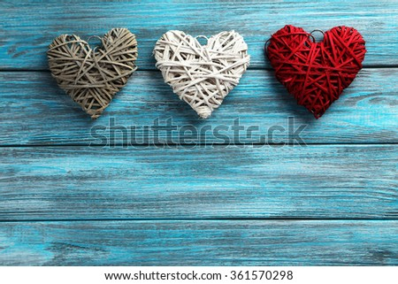 Love hearts on a blue wooden background - stock photo