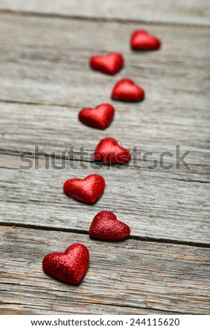 Love hearts on grey wooden background