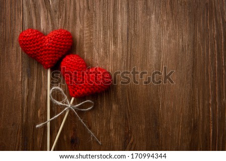 Love hearts on wooden texture background, valentines day card concept - stock photo