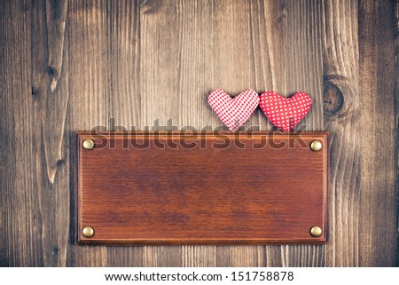 Love hearts, signboard frame on vintage wood background - stock photo