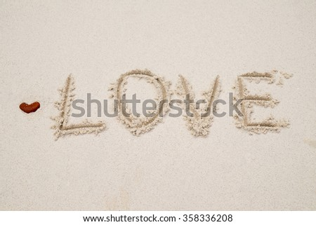 Love in the sand with stone heart.(selective focus) - stock photo