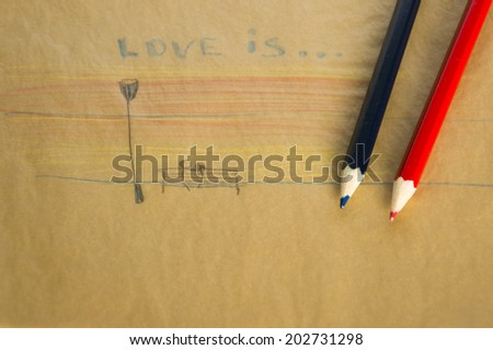 love is... children's drawing love story on the yellow paper color pencils  - stock photo
