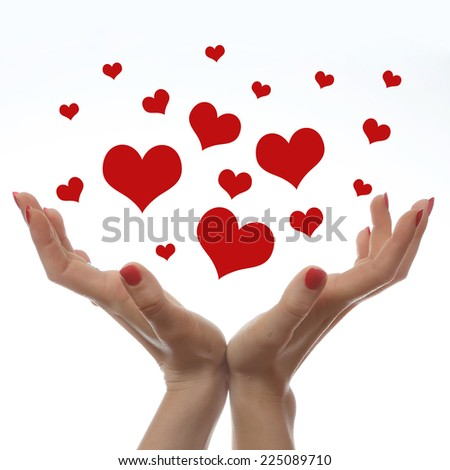 Love is in the air, Red heart shapes in woman's hands against white background. - stock photo