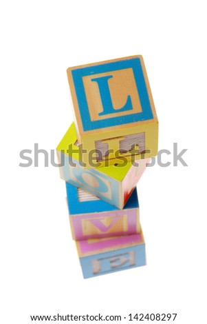 Love - isolated text in wooden building blocks
