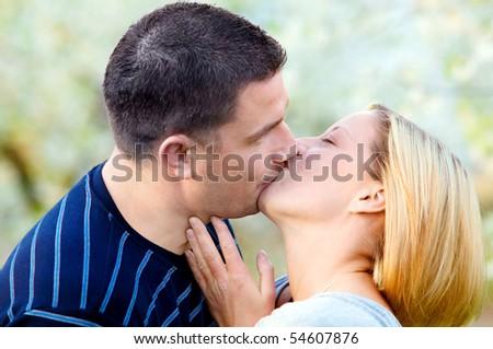 Love kissing. Happy couple kissing in romantic scenery - stock photo