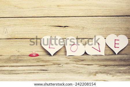 Love, know protected by a condom - stock photo