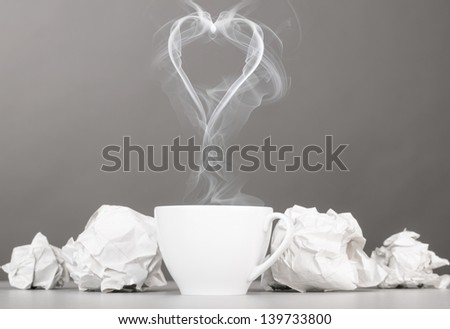 love letter. crumpled wads and heart silhouette on gray - stock photo