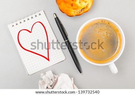 love letter. crumpled wads, notebook with heart picture and cup - stock photo