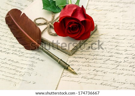 love letters, rose flower and antique feather pen. romantic vintage background. Valentine's Day