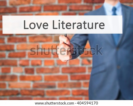 Love Literature - Businessman hand holding sign. Business, technology, internet concept. Stock Photo - stock photo