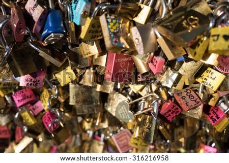love lockers on the bridge �le pont des arts� at Paris France - stock photo